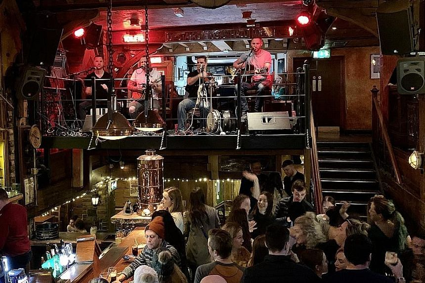 Enjoy music at The Quays Bar and Restaurant in Galway (above) and take a swig of whiskey at the Temple Bar in Dublin.