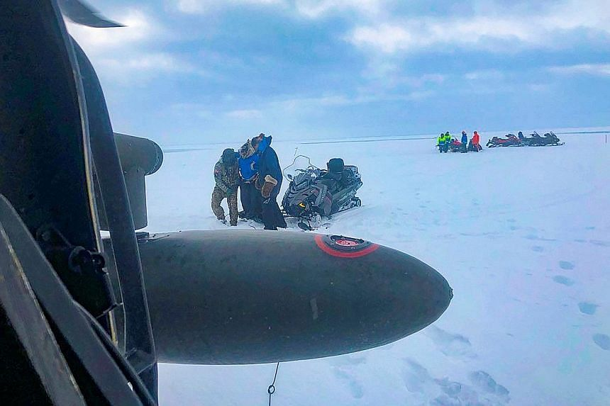 The stranded trio activated their emergency beacons and were plucked from the submerged trail by an Alaska National Guard helicopter team, just 35km from the finish line. They were taken to a hospital for checks and released. Their dogs were also res