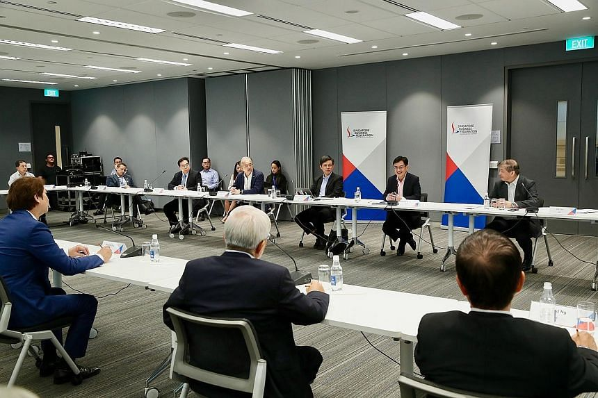 In a Facebook post on Friday, Deputy Prime Minister Heng Swee Keat (second from right, facing camera) said he and Trade and Industry Minister Chan Chun Sing had a dialogue with members of the Singapore Business Federation and trade associations to be