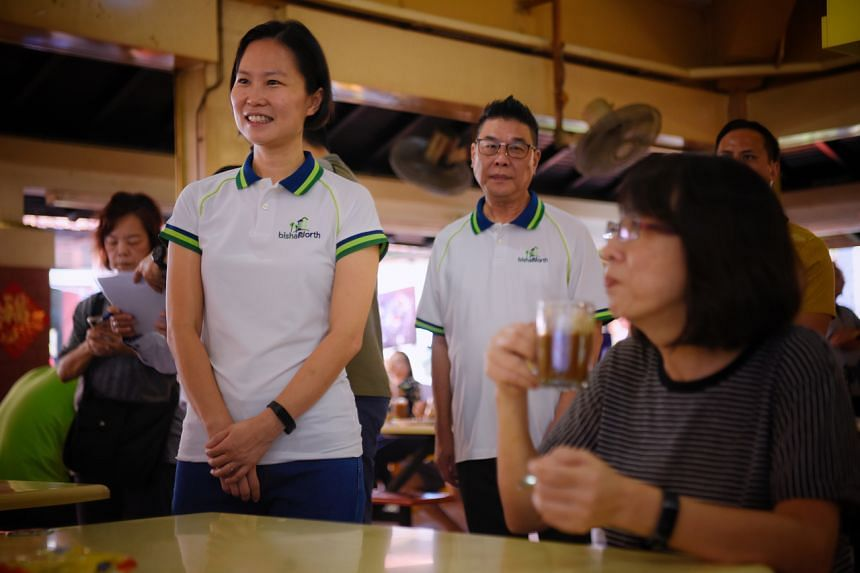 Ms Gan Siow Huang (left), a former Republic of Singapore Air Force general, talks with residents at the 280 Bishan Street 24 coffee shop on March 22, 2020.