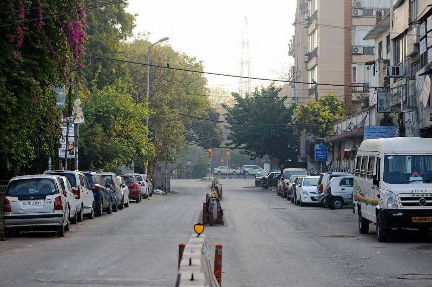 A deserted street is seen during a one-day curfew imposed in New Delhi, India, on March 22, 2020.