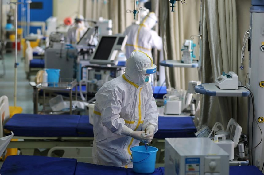 Medical workers prepare the ICU ward for admitting critical patients not related to the coronavirus outbreak, in Wuhan Union Hospital, on March 12, 2020.