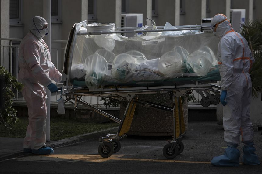 A patient is wheeled into a newly opened Covid-19 hospital wing in Rome, on March 17, 2020.