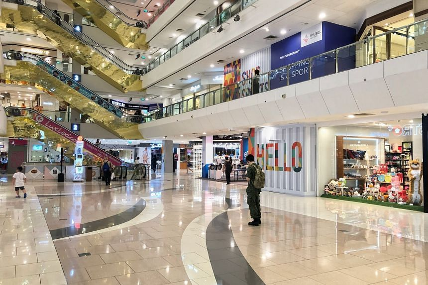 Shoppers in The Centrepoint. Reits here must pay out 90 per cent of their earnings to investors to keep their tax-exempt status.