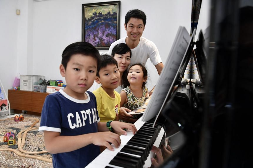 Former banker Alex Tee and his wife Kim Chan Young with (from far left) their sons Emin and Eli and daughter Ena.