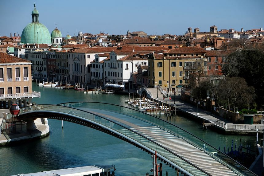 The empty Constitution Bridge on the Grand Canal in Venice last Sunday as Italy imposed a lockdown in the country to slow the spread of the coronavirus.