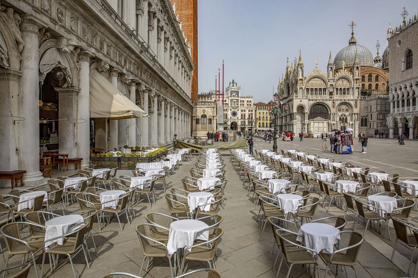 Restaurants and tourist attractions have been similarly hit, with empty tables in Piazza San Marco (above) and an almost deserted St Mark's Square.