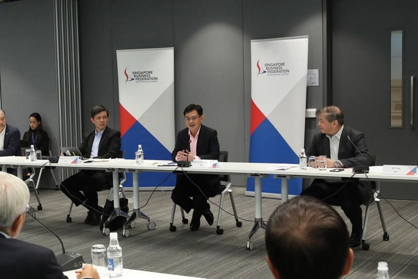 DPM Heng Swee Keat (centre) and Trade and Industry Minister Chan Chun Sing (left) at a closed-door dialogue organised by the Singapore Business Federation with more than 40 business leaders, including trade associations and chambers, on March 20, 202