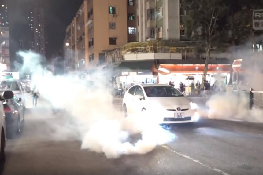 Police fired tear gas and pepper spray during clashes with protesters in Hong Kong's Yuen Long area on March 21, 2020.