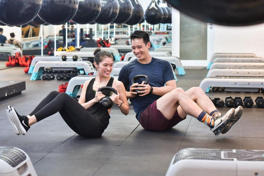 A photo taken on Dec 4, 2018 shows owners of Boom, Ms Victoria Martin-Tay (left) and husband Bryan Tay. The boxing studio is kicking off its online workouts on Monday (March 23) with a session on Instagram Live.