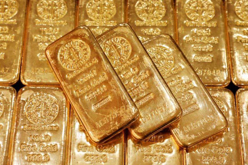 Gold bullions are displayed at GoldSilver Central's office in Singapore, on June 19, 2017.  In Singapore, premiums rose to US$0.70 to US$0.80 (S$1.01 to S$1.16) an ounce versus last week's US$0.50 to US$0.60.