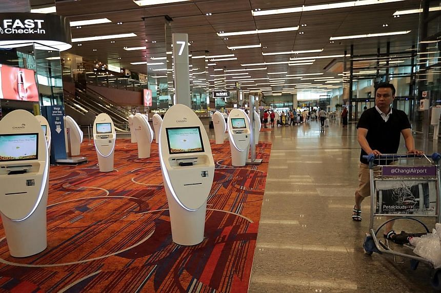Empty self check-in kiosks at Changi Airport last Saturday. Large portions of the economy, such as travel, restaurants and retail, are seeing substantial declines in activity, according to a ClearBridge Investments report.