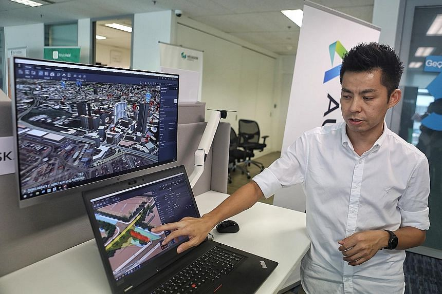 Mr Ho Kah Chun, 37, a technical sales specialist, demonstrating the information provided by Autodesk via the 3D Singapore Sandbox. He is showing how it can be used by planners to understand how certain design could affect the visibility of drivers, i