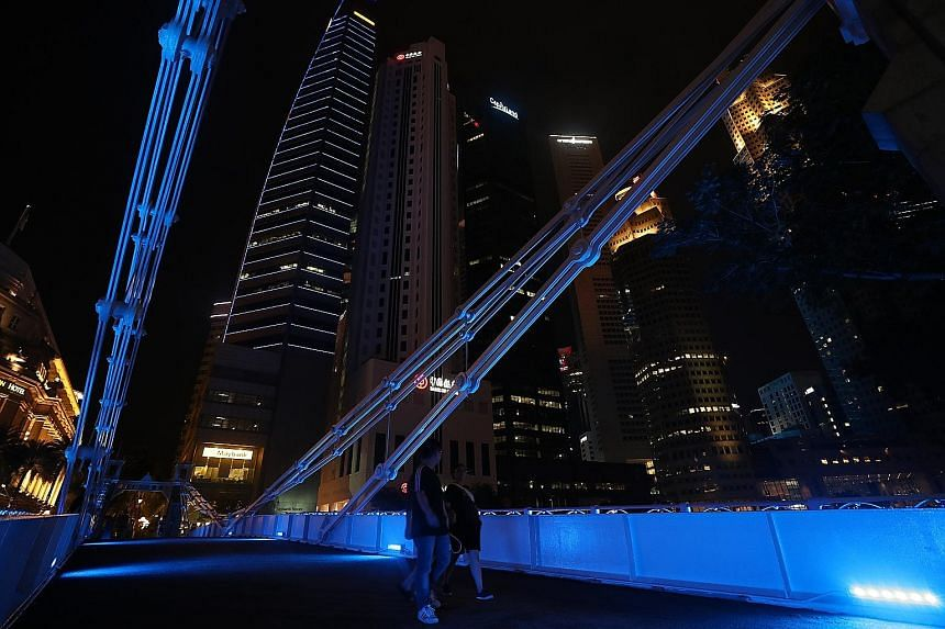 Cavenagh Bridge in the Central Business District lit up in blue yesterday under national water agency PUB's City Turns Blue initiative.