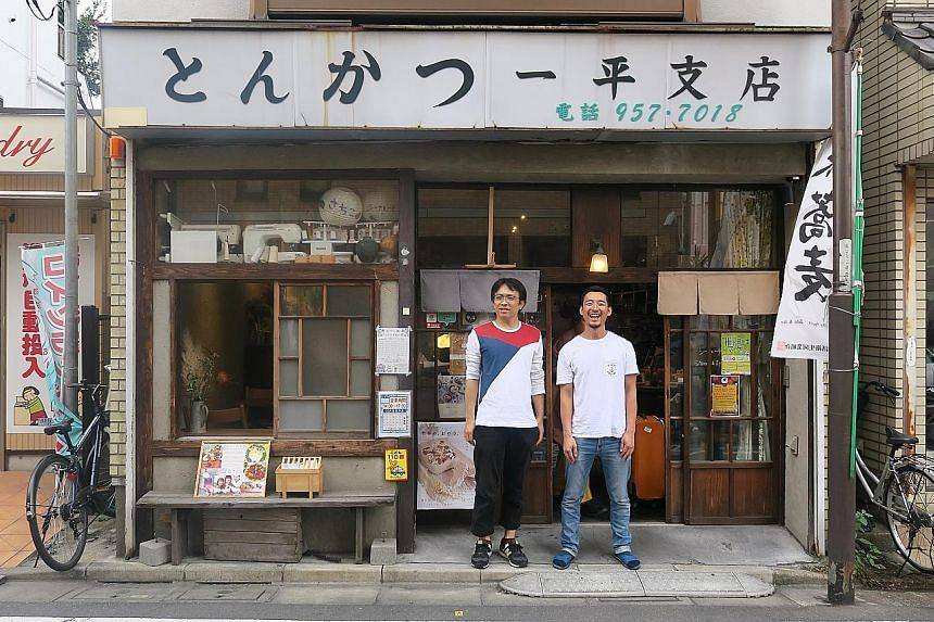 Top: The Minami-Ikebukuro Park has been spruced up to include open spaces. Above: Mr Koichi Hikamiyama (left), 43, and his employee Shota Kaneko, 29, in front of the Sheena and Ippei guesthouse in Shiinamachi district in Toshima. Children from Global
