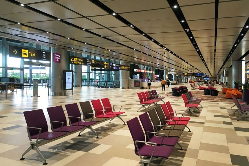 A photo from March 20, 2020, shows an almost-deserted Changi Airport Terminal 4 due to a large number of cancelled flights.