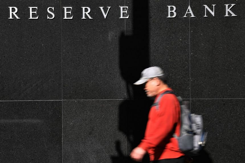 A man walks past the Reserve Bank of Australia in Sydney, Australia, on March 19, 2020.