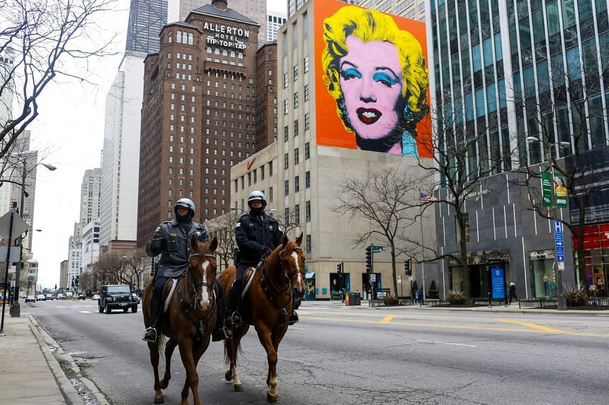 Police officers patrol on horseback along Michigan Avenue in Chicago, on March 21, 2020.