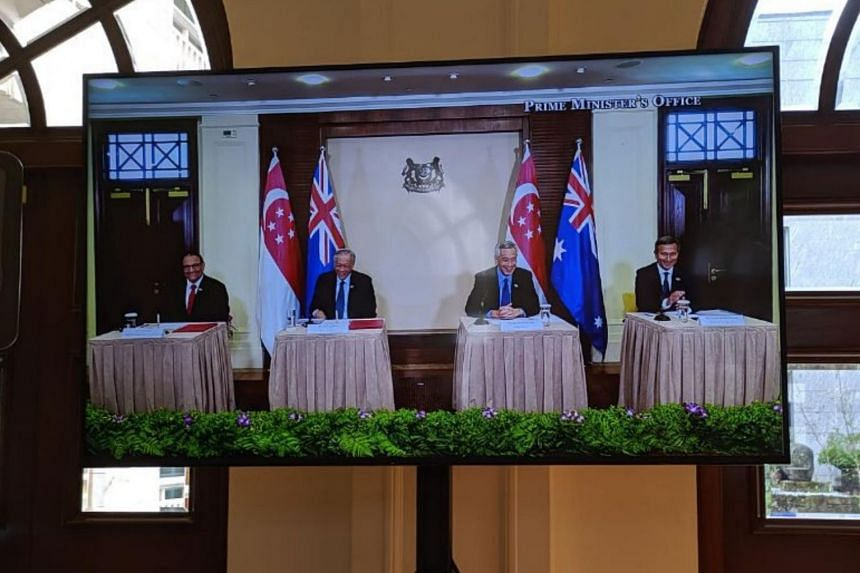 (From left) Communications and Information Minister S. Iswaran, Defence Minister Ng Eng Hen, Prime Minister Lee Hsien Loong and Foreign Minister Vivian Balakrishnan attend a video teleconference on March 23, 2020.