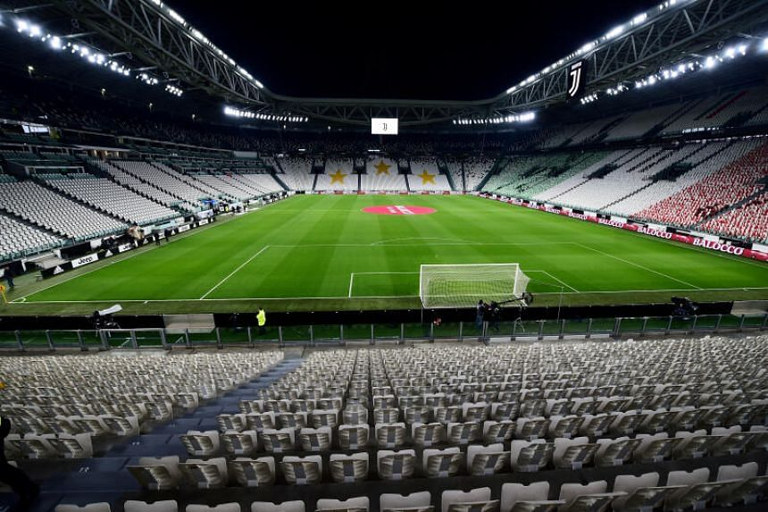 In a photo taken on March 8, 2020, empty seats are seen inside the stadium before a Serie A match between Juventus and Inter Milan is played behind closed doors at the Allianz Stadium in Turin, Italy.