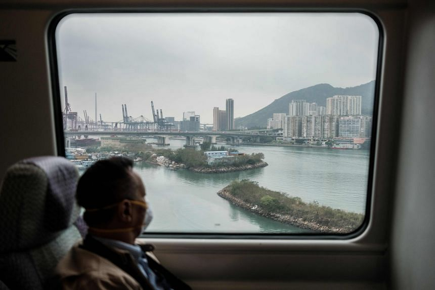 A photo taken on March 19, 2020, shows a passenger in a city-linked train to Hong Kong's international airport.