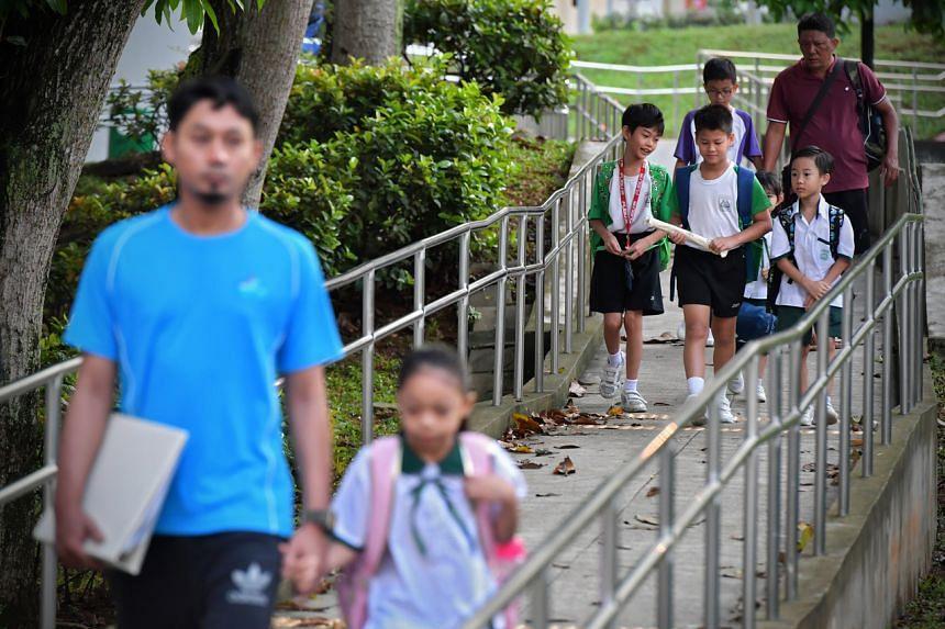 Zhenghua Primary School pupils walking to school on March 23, 2020.