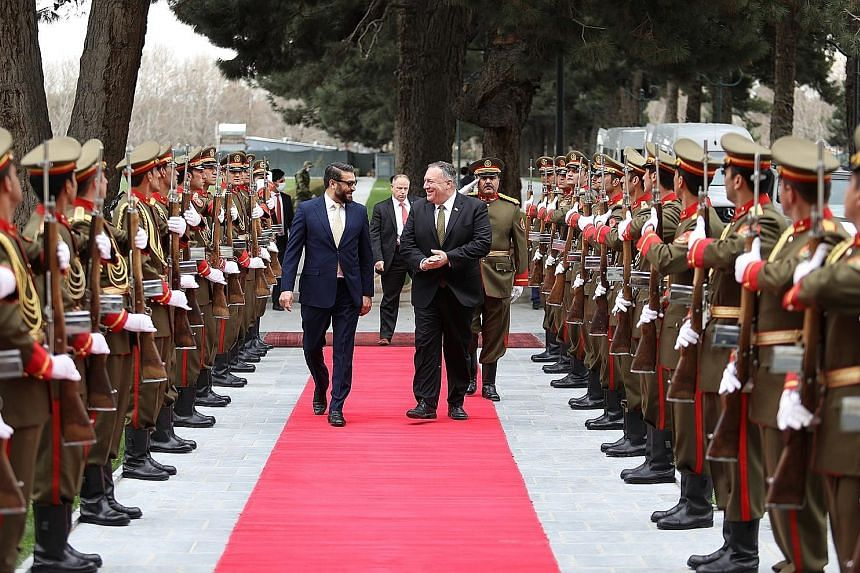 US Secretary of State Mike Pompeo at the presidential palace in Kabul yesterday with Afghan national security adviser Hamdullah Mohib.