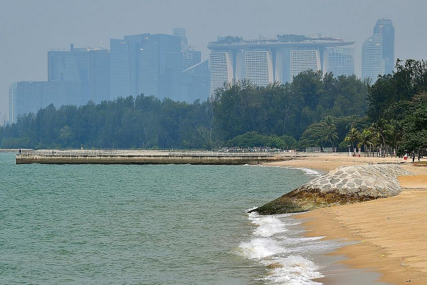 Breakwaters like the one on the right protect sandy beaches and reclaimed shores from waves and erosion. Prime Minister Lee Hsien Loong said Singapore would need to spend $100 billion over the long term to buffer its coast from the rising tides.