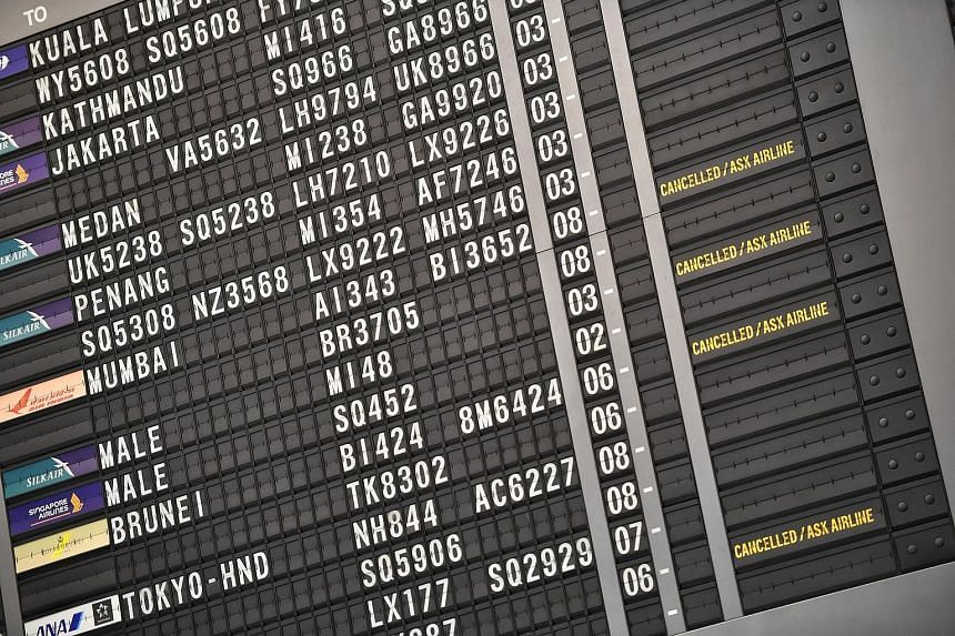 The flight information board at Changi Airport's Terminal 2 showing flight cancellations yesterday. SIA said it is especially vulnerable to international restrictions in air travel because it does not have a domestic segment. ST PHOTO: ARIFFIN JAMAR