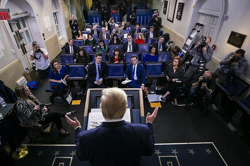 US President Donald Trump speaking during a coronavirus task force news conference at the White House on Sunday. Nearly one-third of Americans are in various phases of virtual lockdown, including in the three biggest cities of New York, Los Angeles a