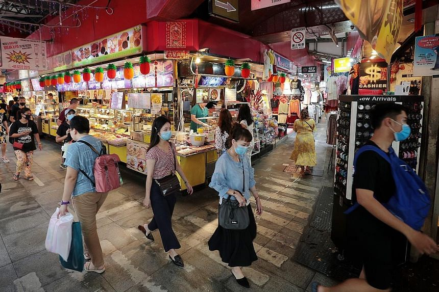 Shoppers at the Bugis street market last month. Core inflation, which excludes the costs of accommodation and private road transport, hit a decade-low when it fell sharply to -0.1 per cent year on year last month, from 0.3 per cent in January. It fel