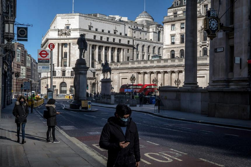 Pedestrians are scarce in the City of London, the financial district, during what is normally the morning rush hour in London, Britain, on March 23, 2020.