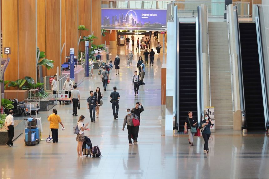Travellers and visitors at Changi Airport Terminal 2 on March 24, 2020.