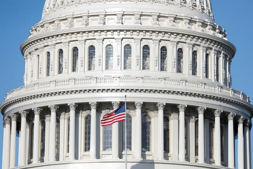 The American Flag flies at the US Capitol Building on Capitol Hill in Washington, US, on March 18, 2020.