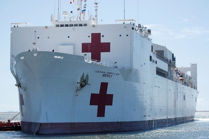 The USNS Mercy, a Navy hospital ship, departs the Naval Station San Diego and heads to the Port of Los Angeles to aid local medical facilities on March 23, 2020.
