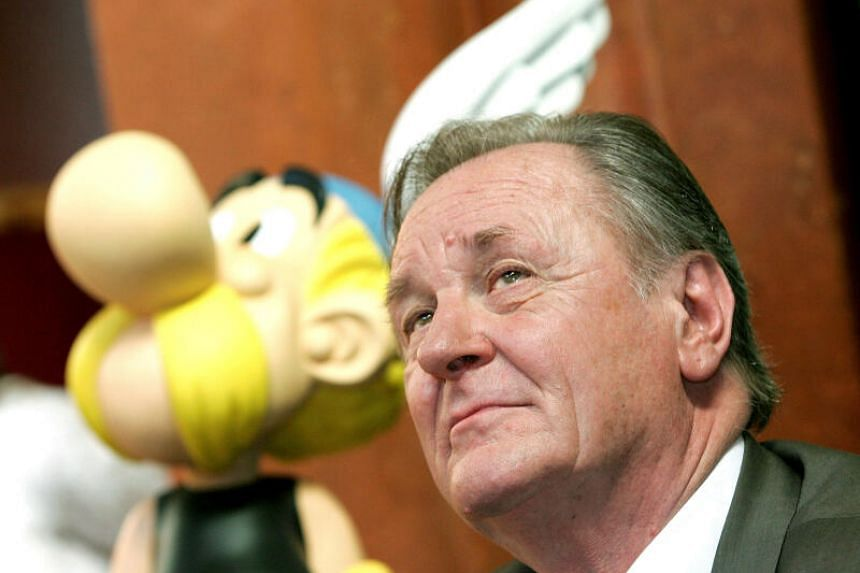 A photo of Albert Uderzo next to a model of Asterix during a news conference in Brussels. He created Asterix in 1959 with the writer Rene Goscinny, who brought them to life in the French-Belgian comics magazine Pilote.