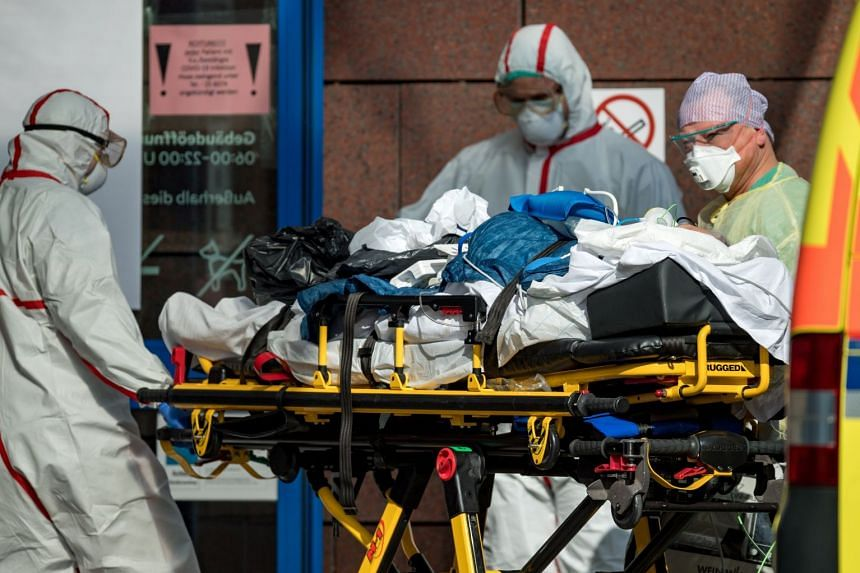 An Italian patient infected with coronavirus arrives at a hospital in Leipzig, Germany, March 25, 2020.