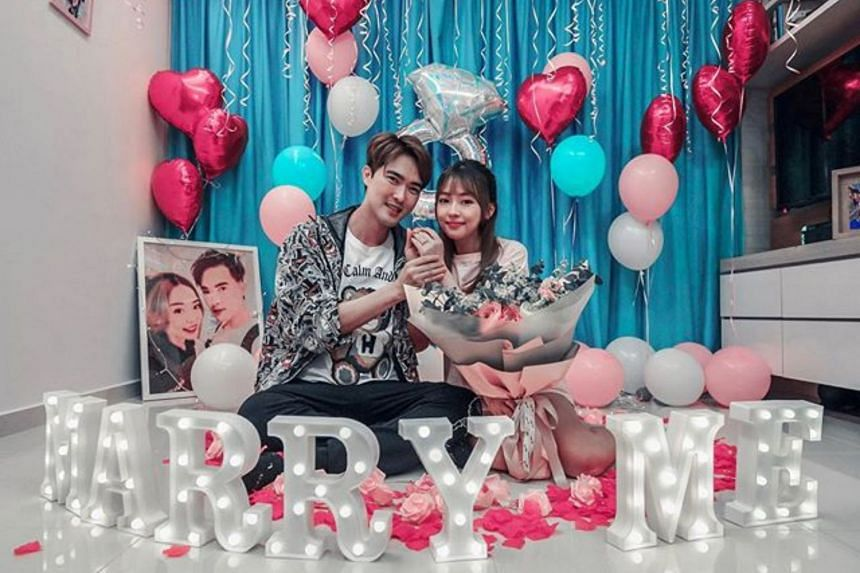 A picture posted by Lee Teng shows a thoughtful proposal that unfolded in a room filled with balloons, flower petals and photos of the couple.