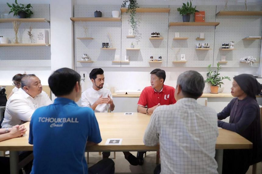 NTUC Secretary General Ng Chee Meng interacts with freelancers in a cafe along Havelock Road on March 25, 2020.