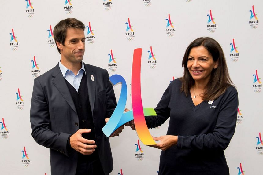 A 2017 photo shows Estanguet (left) during a press conference in Peru with Paris Mayor Anne Hidalgo.