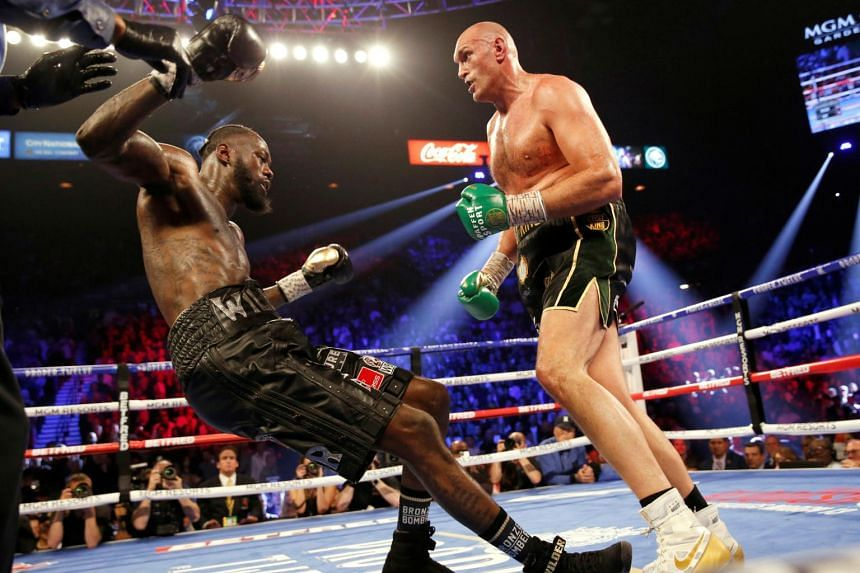 Tyson Fury knocks down Deontay Wilder during the fight, on Feb 22, 2020.
