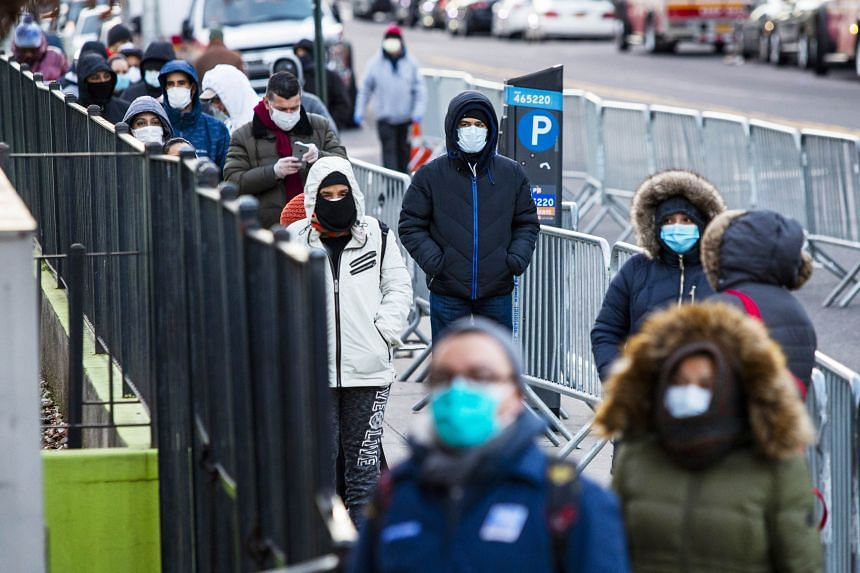 People line up to get a test at Elmhurst Hospital in Queens, New York, on March 24, 2020.