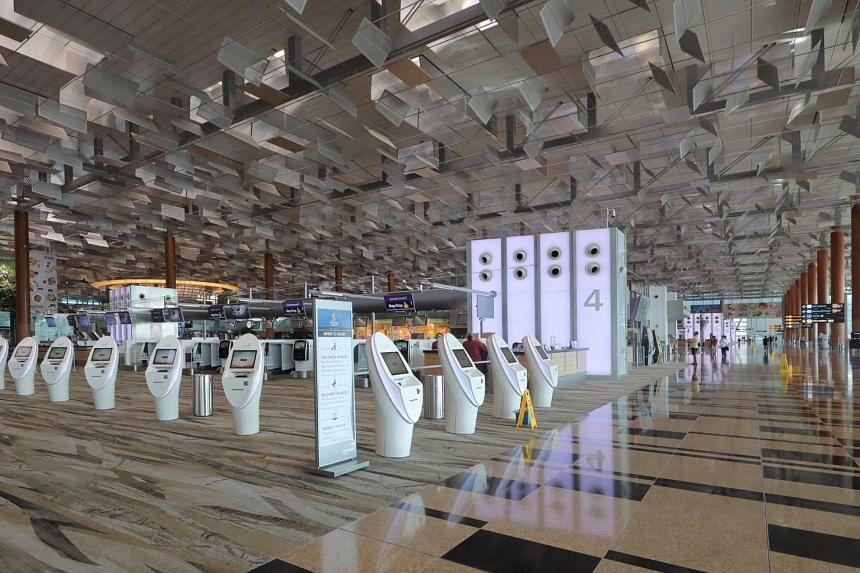 An almost-deserted Changi Airport terminal 3 due to a large number of cancelled flights, on March 24, 2020.