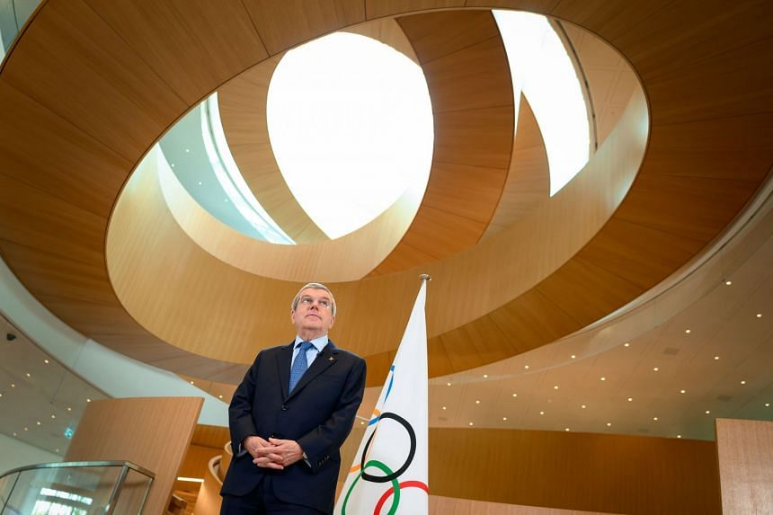 A March 3, 2020 photo shows IOC president Thomas Bach delivering a statement on Covid-19.