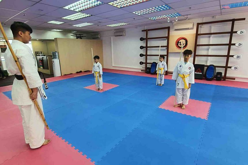 Students during a class at Rei Academy on March 24, 2020. This class usually comprises six students, but was split into two classes of three for the purpose of social distancing.
