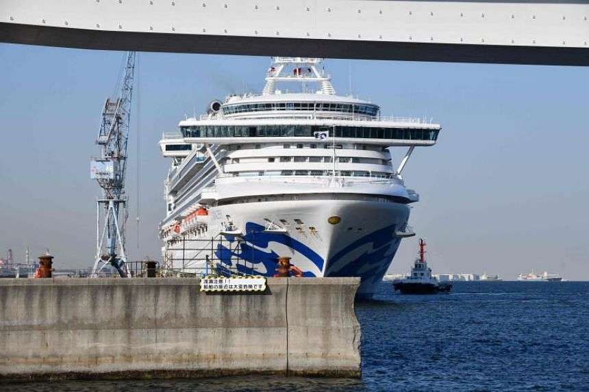 The Diamond Princess cruise ship is seen at a pier at the port of Yokohama in Japan on March 25, 2020.