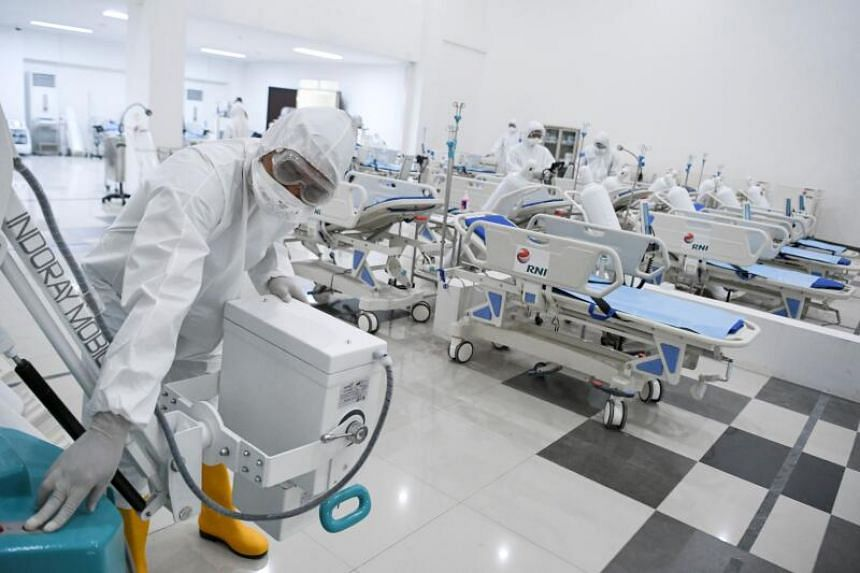 Indonesian medical staff prepare a room for patients at the 2018 Asian Games athlete's village which has been converted into a hospital for Covid-19 coronavirus patients in Jakarta, on March 23, 2020.