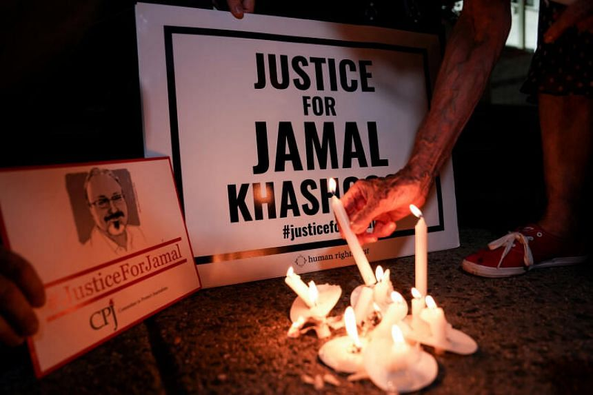 In a photo taken on Oct 2, 2019, the Committee to Protect Journalists and other press freedom activists hold a candlelight vigil in front of the Saudi Embassy to mark the anniversary of the killing of journalist Jamal Khashoggi at the kingdom's consu