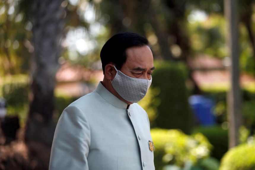 Thai Prime Minister Prayut Chan-o-cha wears a protective mask due to the coronavirus outbreak, as he comes out from a meeting at Government House in Bangkok, on March 24, 2020.