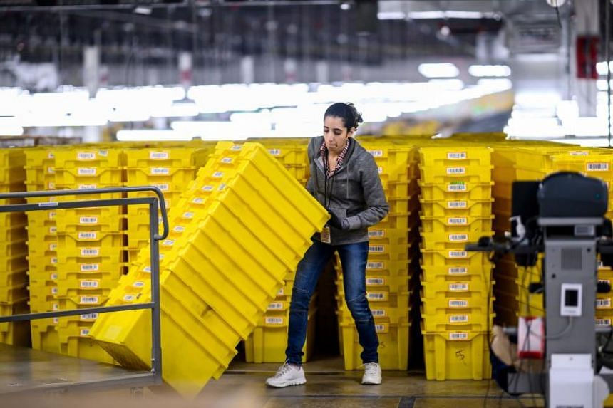 In a file photo taken on Feb 5, 2019 a woman works at the 855,000-sq-ft Amazon fulfillment centre in Staten Island, New York.